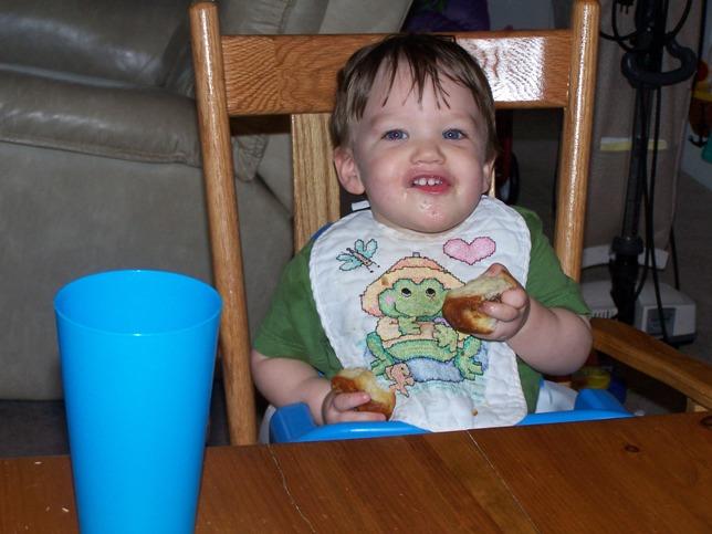 Michael enjoys one of Papa's Sweet Rolls